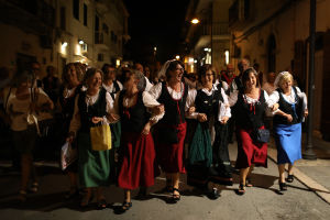 A folklore choir group from the town of Castel del Monte in Abruzzo performs in the town of Vieste in the province of Foggia, Puglia, Italy, September 17, 2016. REUTERS/Siegfried Modola